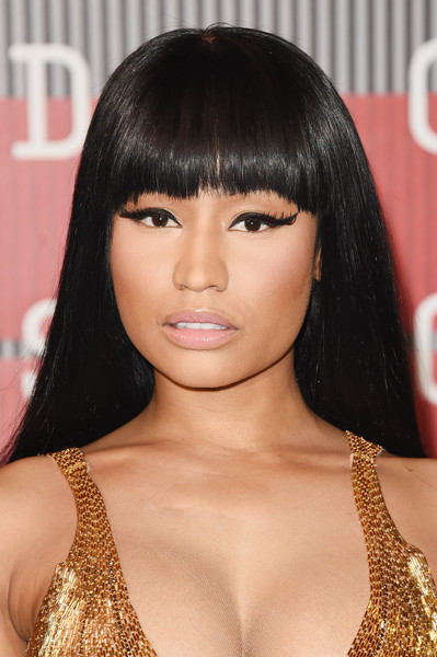 Nicki Minaj contrasted her elaborate eye makeup with barely-there pink lipstick.