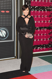 Kris Jenner vamped it up at the MTV VMAs in a figure-hugging black gown with a strappy, plunging neckline.