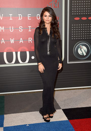 Selena Gomez opted for a figure-skimming black knit gown by Calvin Klein for her MTV VMAs look.