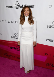 Sticking to an all-white motif, Naya Rivera paired her bodysuit with a Halston Heritage maxi skirt.