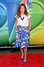 Debra Messing paired her top with a print skirt in a vibrant mix of colors.