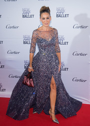 Sarah Jessica Parker polished off her sparkly ensemble with a sequined burgundy purse by Chanel.