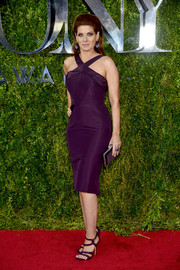 Debra Messing made an ultra-sophisticated appearance at the Tony Awards in a curve-hugging purple halter dress by Zac Posen.