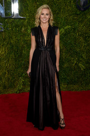 Laura Bell Bundy was edgy-glam at the Tony Awards in a Black Halo sheer-illusion gown with a deep-V neckline and a thigh-high slit.