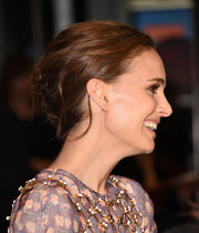 Natalie Portman pulled her hair back into a messy-glam bobby-pinned updo for the TIFF kickoff fundraising soiree.