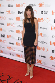 Sandra Bullock's David Koma frock at the TIFF premiere of 'Our Brand is Crisis' was an ultra-modern take on the classic LBD with its see-through, geometric-patterned yoke and skirt.