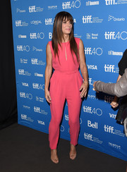 Sandra Bullock was a delight to the eyes in her hot-pink Max Mara jumpsuit during the press conference for 'Our Brand is Crisis.'