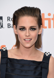 Kristen Stewart looked punk-chic at the TIFF premiere of 'Equals' wearing this straight, brushed-back 'do.