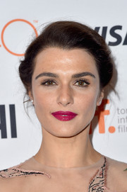 For her lips, Rachel Weisz chose a bold berry hue.