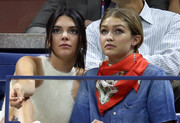 Gigi Hadid styled her denim shirt with a printed silk scarf for day 9 of the 2015 U.S. Open.