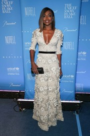 Patina Miller chose a black satin clutch by Rodo to finish off her look.
