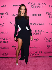 Alessandra Ambrosio looked uncharacteristically conservative (even with that thigh-high slit) in a long-sleeve monochrome column dress by Mugler at the Victoria's Secret fashion show after-party.