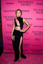 Gigi Hadid amped up the sex appeal with a long black double-slit skirt by Sally LaPointe.