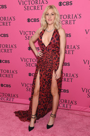 Ellie Goulding oozed sex appeal at the Victoria's Secret fashion show in a red Versus Versace leopard-print gown with a cleavage-flaunting neckline and double slits.