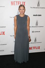 Elisha Cuthbert opted for a simple gray gown when she attended the Weinstein Company and Netflix Golden Globes party.