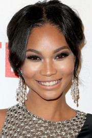 Chanel Iman accessorized with a pair of diamond chandelier earrings that echoed the embellishments on her dress.