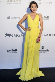 Zhang Zilin attended the amfAR Hong Kong Gala wearing a wrap gown in a gorgeous yellow hue.