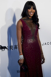 Naomi Campbell went all out with the sparkle at the amfAR Hong Kong Gala, teaming layers of Harry Winston diamond bracelets with a beaded gown.