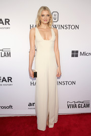 Lily Donaldson flashed some cleavage in a low-cut white gown by Calvin Klein at the amfAR Inspiration Gala.