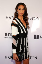 Joan Smalls styled her black-and-white mini dress with a classic envelope clutch when she attended the amfAR Inspiration Gala.