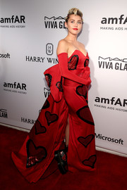 Miley Cyrus totally stood out in a heart-embellished red strapless gown by Moschino at the amfAR Inspiration Gala.