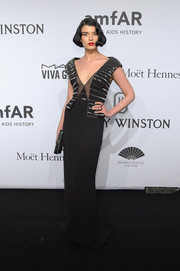 Crystal Renn was all about vintage glamour at the amfAR New York Gala in a black column dress with an embellished, sheer-panel bodice.