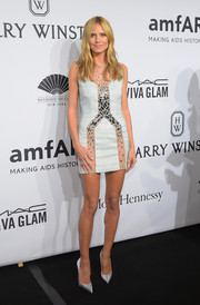 Heidi Klum sizzled in an embellished, sheer-panel micro-mini dress by Azzaro Couture at the amfAR New York Gala.