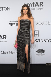 Isabeli Fontana went for edgy sophistication at the amfAR New York Gala in a textured gunmetal-gray strapless gown with a thigh-high slit.