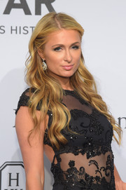Paris Hilton wore her hair in lovely cascade of waves with the sides clipped back during the amfAR New York Gala.