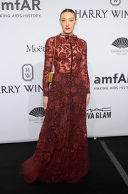 Mia Moretti went the ultra-ladylike route in a flower-appliqued red gown during the amfAR New York Gala.
