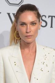 Erin Wasson rocked an edgy ponytail to match her menswear-inspired outfit at the amfAR New York Gala.
