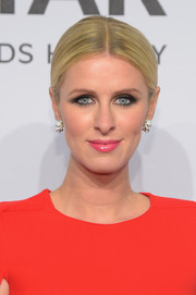 Nicky Hilton came simply styled with this center-parted ponytail to the amfAR New York Gala.