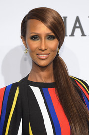 Iman attended the amfAR New York Gala wearing a sleek side ponytail.