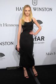 Ginta Lapina chose a simple LBD with waist cutouts for her amfAR New York Gala look.