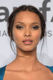 Lais Ribeiro attended the amfAR New York Gala wearing her hair in a slouchy center-parted updo with a few loose strands.