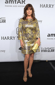 Marcia Gay Harden added an extra pop of yellow to her dress with a chic snakeskin envelope clutch.