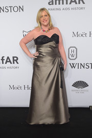 Amy Sacco looked tres chic in a structured gold and black strapless gown at the amfAR New York Gala.