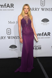 Eniko Mihalik made an ultra-glam statement at the amfAR New York Gala in a slinky purple gown with web-like beading on the bodice.