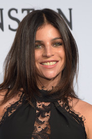 Julia Restoin-Roitfeld attended the amfAR New York Gala wearing her trademark center part.