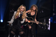 Singers Madonna (L) and Taylor Swift perform 'Ghost Town' onstage during the 2015 iHeartRadio Music Awards which broadcasted live on NBC from The Shrine Auditorium on March 29, 2015 in Los Angeles, California.