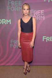Ashley Benson styled her top with a red leather pencil skirt.