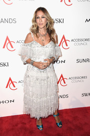 Sarah Jessica Parker paired her dress with elegant teal satin sandals from her own line.