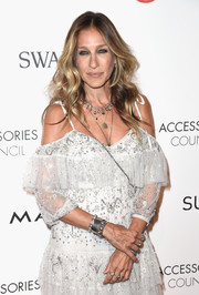 Sarah Jessica Parker loaded up on the bling, including a chic embellished silver cuff, for the 2016 ACE Awards.