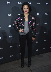 Demi Lovato teamed a lipstick-print bomber jacket by Giamba with black skinny jeans for the 2016 AOL NewFront.