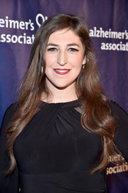 Mayim Bialik wore her hair down with gentle waves when she attended the Alzheimer Association's A Night at Sardi's event.