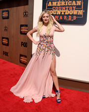 Kelsea Ballerini added an extra splash of color with a pair of cobalt ankle-tie sandals by Stuart Weitzman.