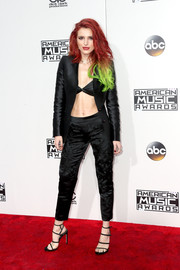 Bella Thorne flashed her athletic abs in a black Anthony Franco blazer teamed with a black bra at the 2016 AMAs.