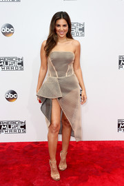 Liz Hernandez showed lots of skin in a strapless nude mesh dress layered over a black bodysuit at the 2016 AMAs.
