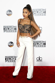 Ariana Grande went sultry in a lacy corset top at the 2016 AMAs.