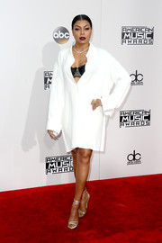 Taraji P. Henson chose a loose white Celine shirtdress, which she wore partially unbuttoned to reveal a black bra, for the 2016 AMAs.